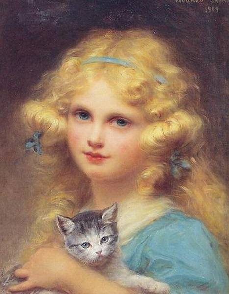 Portrait of a young girl holding a kitten